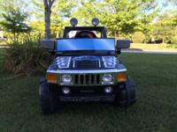 Barely used electric jeep for boys. Rides just like a
