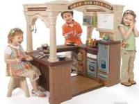 Gently used walk-in play kitchen. We received it brand