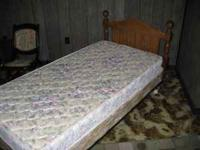 For sale is a twin size bed with a wood headboard,