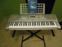 You're looking at a Yamaha PSR-E303 YPT300 electronic