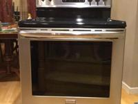 Five burner, glass top stove. Three rack oven with
