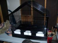 I am selling a cockatiel cage-lightly used,looks like