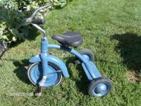 I believe that this is a little girls tricycle that I