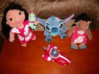 This set includes 2 Lilo plush 1 with yarn hair holding