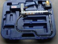 This is a 12-volt Lincoln Power-Luber grease gun. It