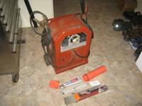 Big, heavy, tough, old welder. Used it for years now,