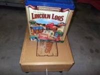 Selling a bunch of lincoln logs with a rollable storage