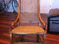 Strong wood with caned back and seat. Back is original