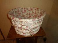 LINED WICKER LAUNDRY BASKET, HAS PINK ROSE LINING,