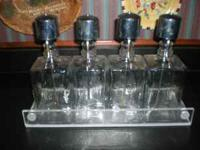 This is a vintage liquor bottle bar set, consisting of