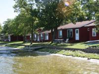 Established lakes area resort featuring 12 cabins,