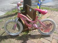 Pink bike with matching Barbie seat and Barbie graphics