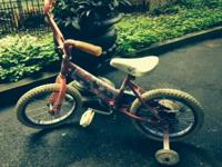 Selling this little girl's Barbie bicycle with training
