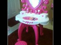Little girl's kitchen and Barbie vanity bit are