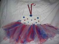 Pictured is a two patriotic tutus one is size 6-24