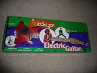 "For sale: ""Little Lyon"" Electric 6 string guitar! Made"