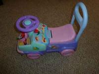 Really cute pink purple and blue little scooter car.