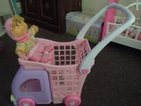 Younger baby dolls can sit up top in the cart so mommy