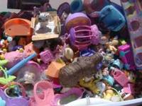 Large bin of little pet shop toys. The price ranges