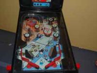 little pin ball machine monopoly theme asking 50 can