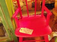 This is an aged vintage red child's shaking chair. It