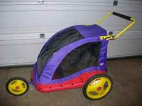Little Tikes bicycle trailer. Features screen closure