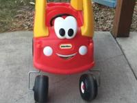 Your child will love driving around in the red Cozy