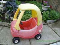 This is a Little Tikes cozy coupe car in good condition