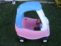 little tikes cozy coupe in pink, white and blue. has
