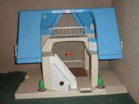 "Little Tikes Doll House. Base is 28"" L X 17 "" W And the"