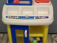 For sale is a little tikes grocery stand with play