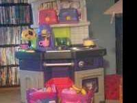 Selling good condition little tikes kitchen with two