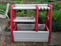 This is a durable and nice gray and red storage bin for