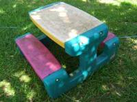 A Little Tikes Picnic Table. Has some cracks in the