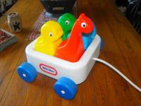 This is a vintage little tikes plastic wagon with 4