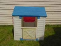 Little Tikes Playhouse for sale. A little sun faded,