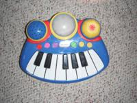 This item is a Little Tikes pop tune big rocker piano.