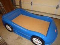Little Tikes Race Car Bed. Blue in color. Excellent