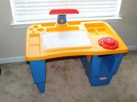 The big, tough Little Tikes art desk is wonderful for
