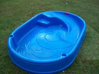 Pool has built in slide and sprayer