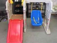 This is a Little Tikes Castle swing with a slide for
