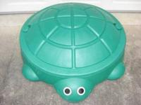 Little Tikes turtle sandbox. It is a large green sand