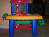 little tike s work bench with additional tools. call or