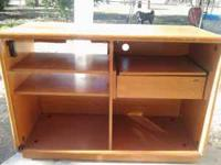 Wood, about 3 feet tall. Drawer and shelves. 2 clear
