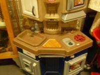 This great Little Tykes play kitchen can be seen in our