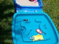 Great condition,  sand/water table.  One side covers