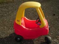 A red and yellow little tikes cozy coupe care for $20.