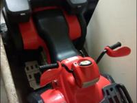 I am selling a motorized Little Tikes Trike along with