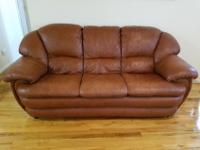Full size leather sofa, love seat and armchair. In