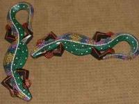 2 very colorful lizzard shaped wall hangings. GREAT